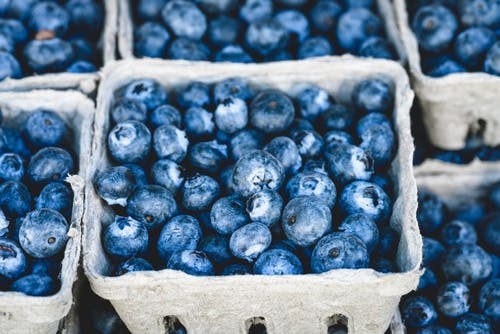 Frozen blueberries in a gray box