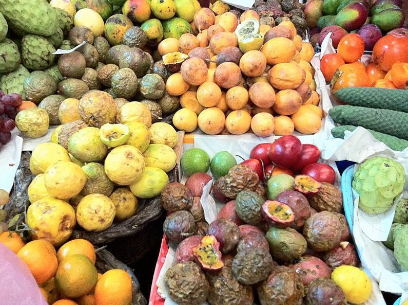 A variety of passion fruits at a market in Portugal